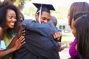 African American Student Celebrates Graduation Smiling